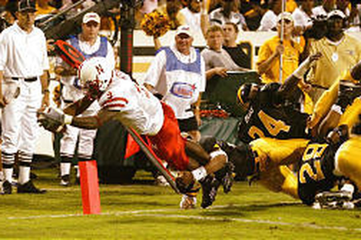 Nebraska's David Horne (9) leaps into the end zone for a touchdown against Southern Mississippi.