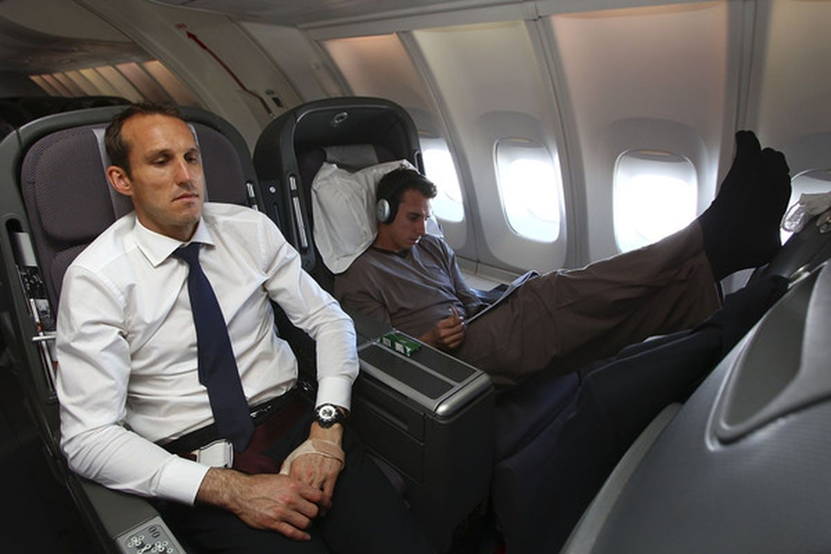 IN FLIGHT, UNSPECIFIED  - MAY 26:  Mark Schwarzer and Luke Wiltshire (R) of the Australian Socceroos relax in-flight en route to Johannesburg in South Africa for the 2010 FIFA World Cup on May 26, 2010. (Photo by Robert Cianflone/Getty Images)