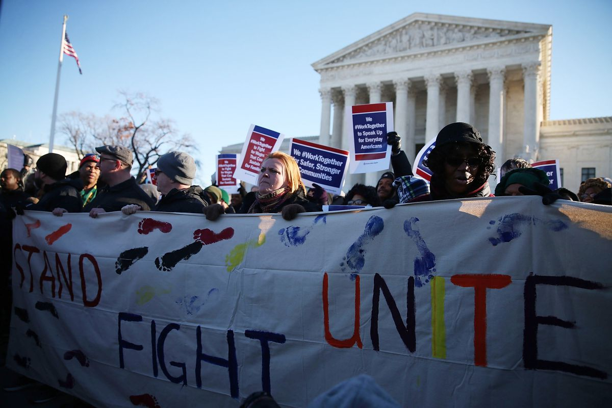 Pro union protesters rally in front of the US Supreme Court building January 11, 2016