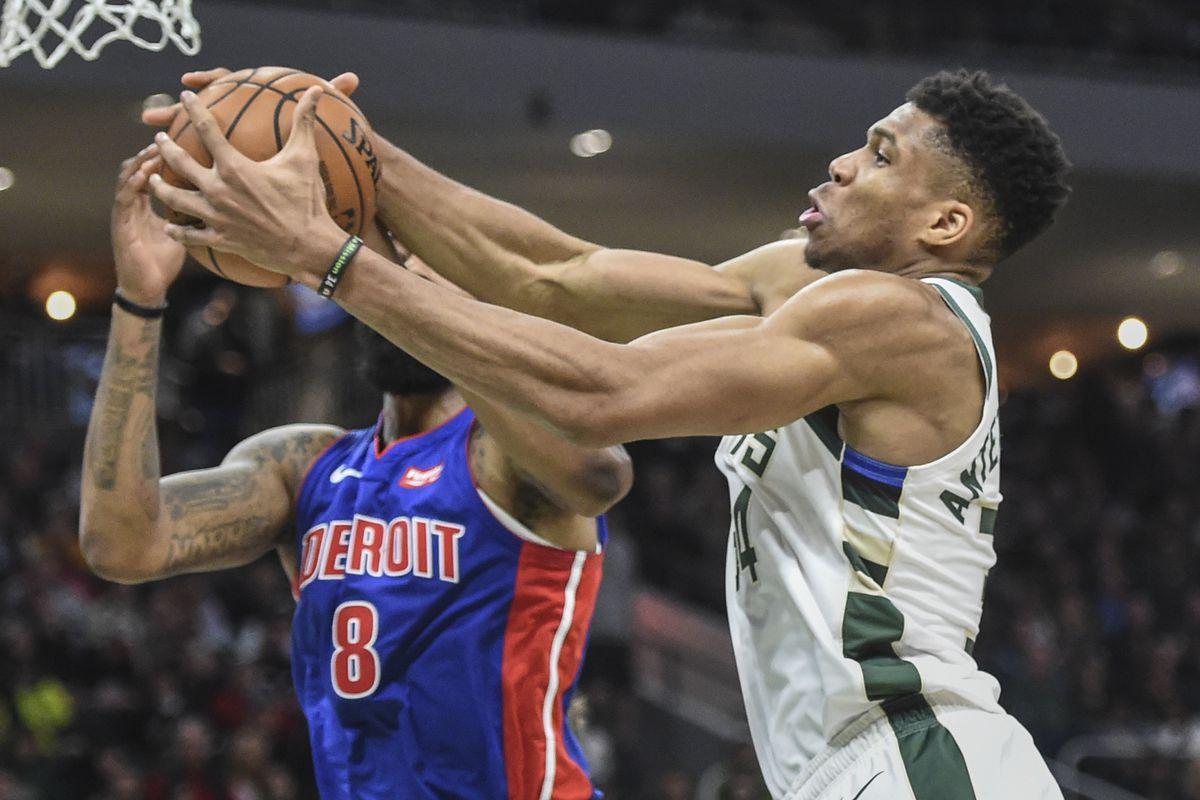 Milwaukee Bucks forward Giannis Antetokounmpo grabs a rebound against Detroit Pistons forward Markieff Morris in the third quarter at Fiserv Forum.