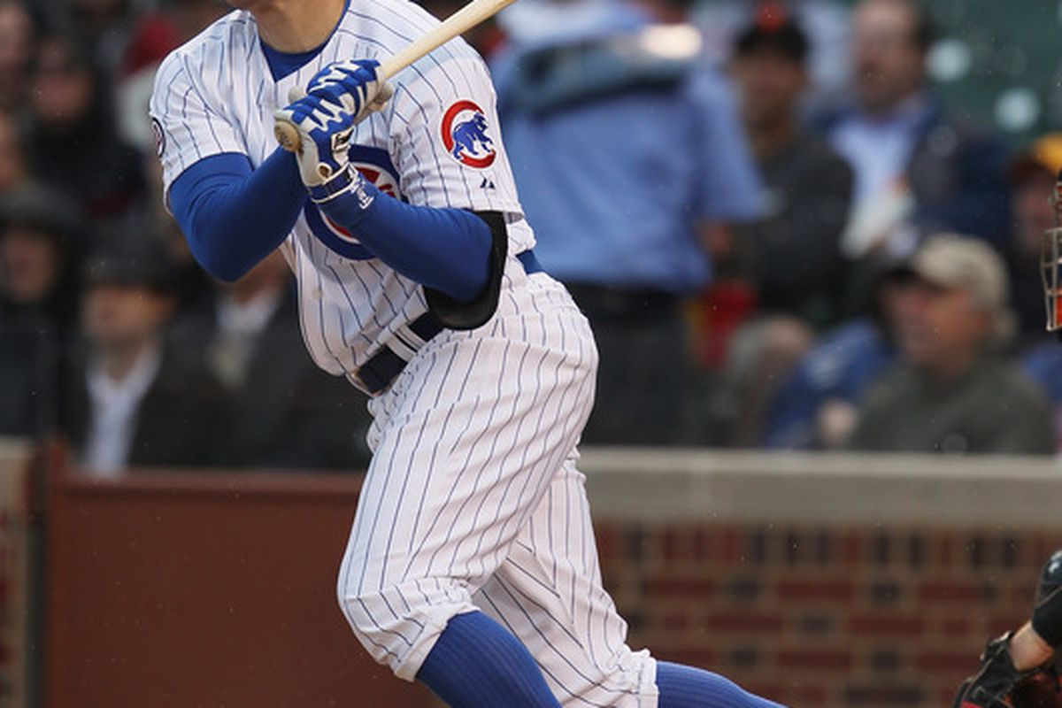Jeff Baker of the Chicago Cubs hits a single in the 7th inning against the San Francisco Giants at Wrigley Field on May 13, 2011 in Chicago, Illinois. The Cubs defeated the Giants 11-4. (Photo by Jonathan Daniel/Getty Images)
