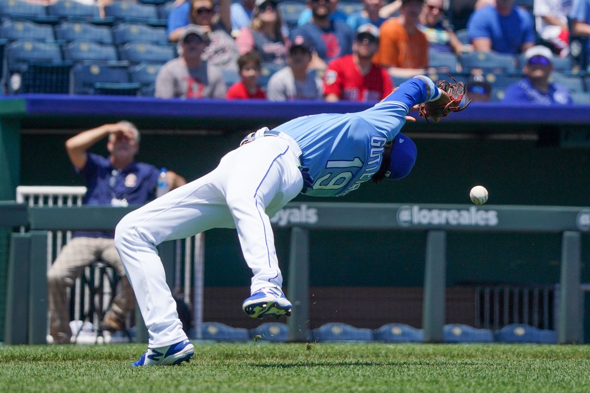 Kansas City Royals third baseman Kelvin Gutierrez (19) mis-judges and misses a pop fly ball in the first inning against the Boston Red Sox at Kauffman Stadium.