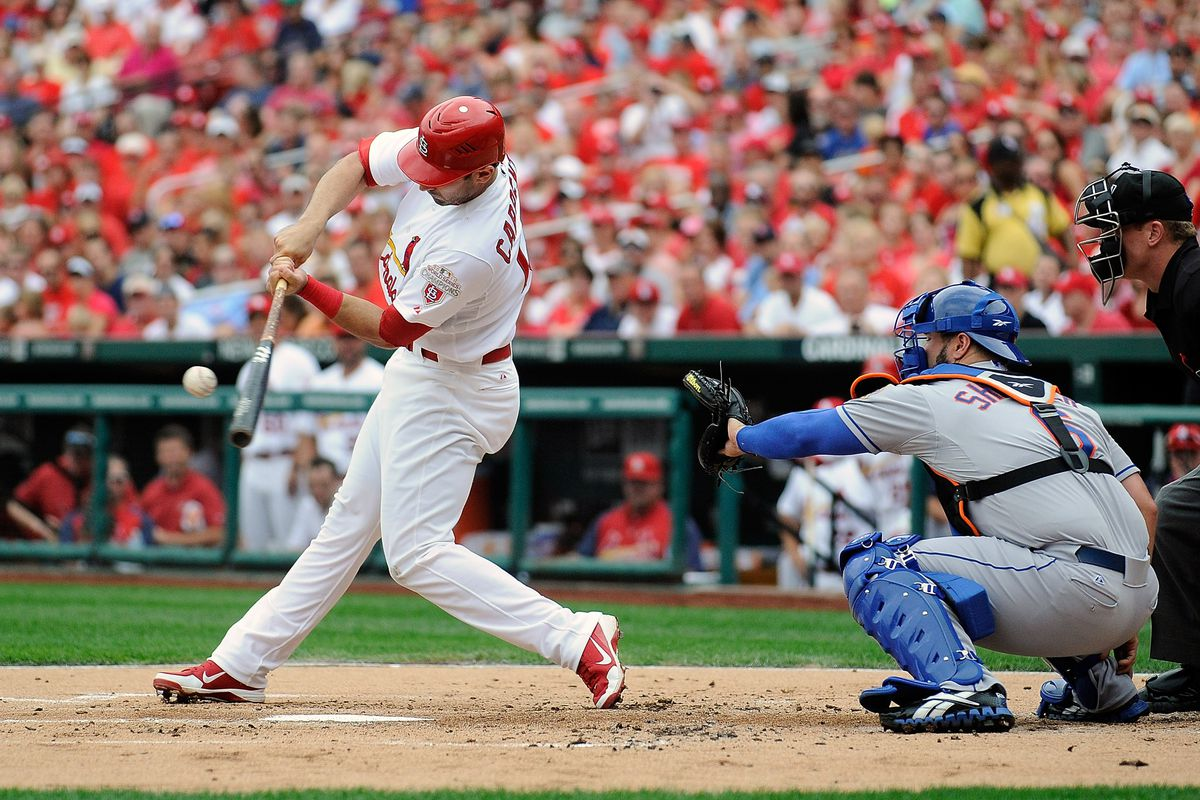 ST. LOUIS, MO - SEPTEMBER 3: Matt Carpenter #13 of the St. Louis Cardinals drives in Jon Jay #19 during the first inning against the New York Mets at Busch Stadium on September 3, 2012 in St. Louis, Missouri. (Photo by Jeff Curry/Getty Images)