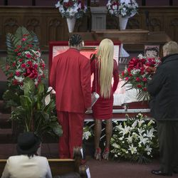 Garry Mullen, the husband of Bettie Jones, and their daughter, 19-year-old LaTisha Jones, attend the funeral services for Bettie Jones at New Mount Pilgrim Missionary Baptist Church on Wednesday, Jan. 6, 2016.