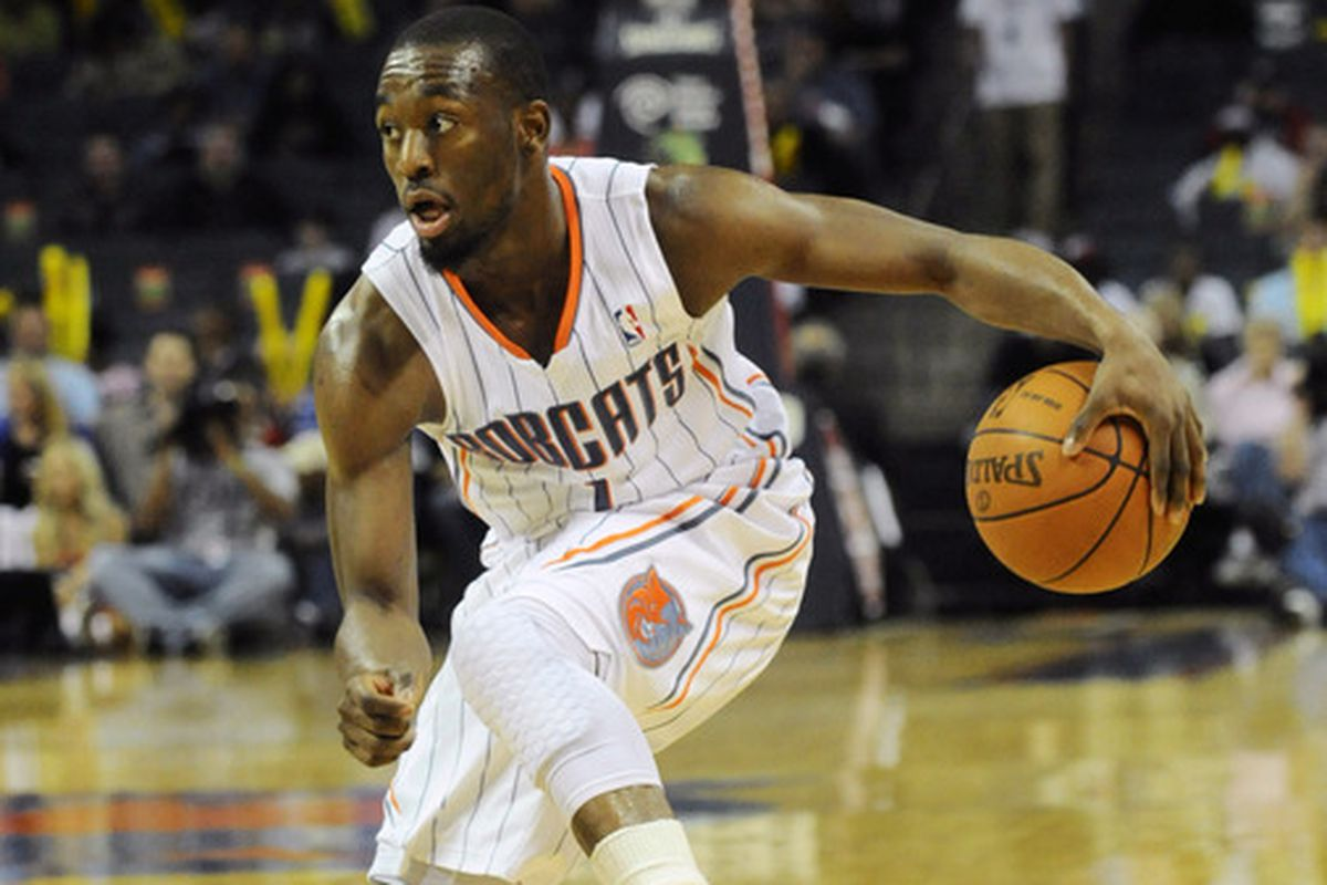April 22, 2012; Charlotte, NC, USA; Charlotte Bobcats guard Kemba Walker (1) prepares to drive towards the basket during the game against the Sacramento Kings at Time Warner Cable Arena.  Kings win 114-88. Mandatory Credit: Sam Sharpe-US PRESSWIRE