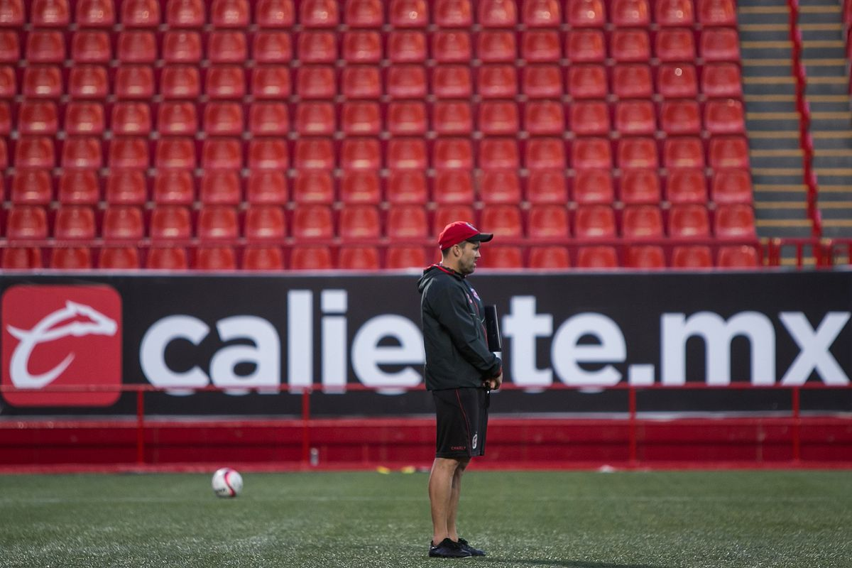 """Tijuana manager Eduardo """"Chacho"""" Coudet surveys his squad during Xolos' final practice before the 2017 Apertura."""
