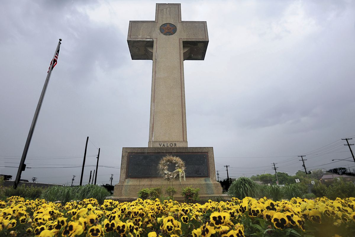 FILE - In this May 7, 2014 file photo, the World War I memorial cross is pictured in Bladensburg, Md. The American Legion and other supporters of the cross-shaped war monument on a Maryland highway median just outside Washington have asked a federal appea