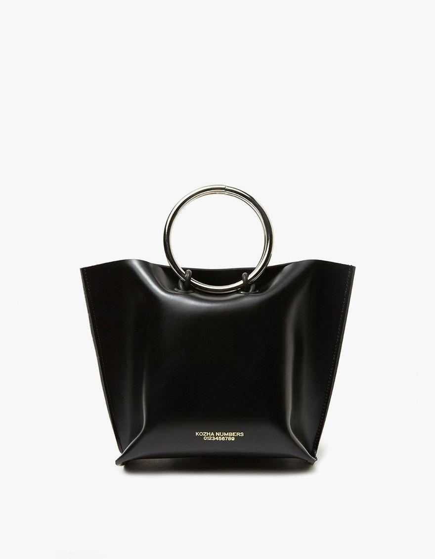 Black leather bag with metal circle top handle.