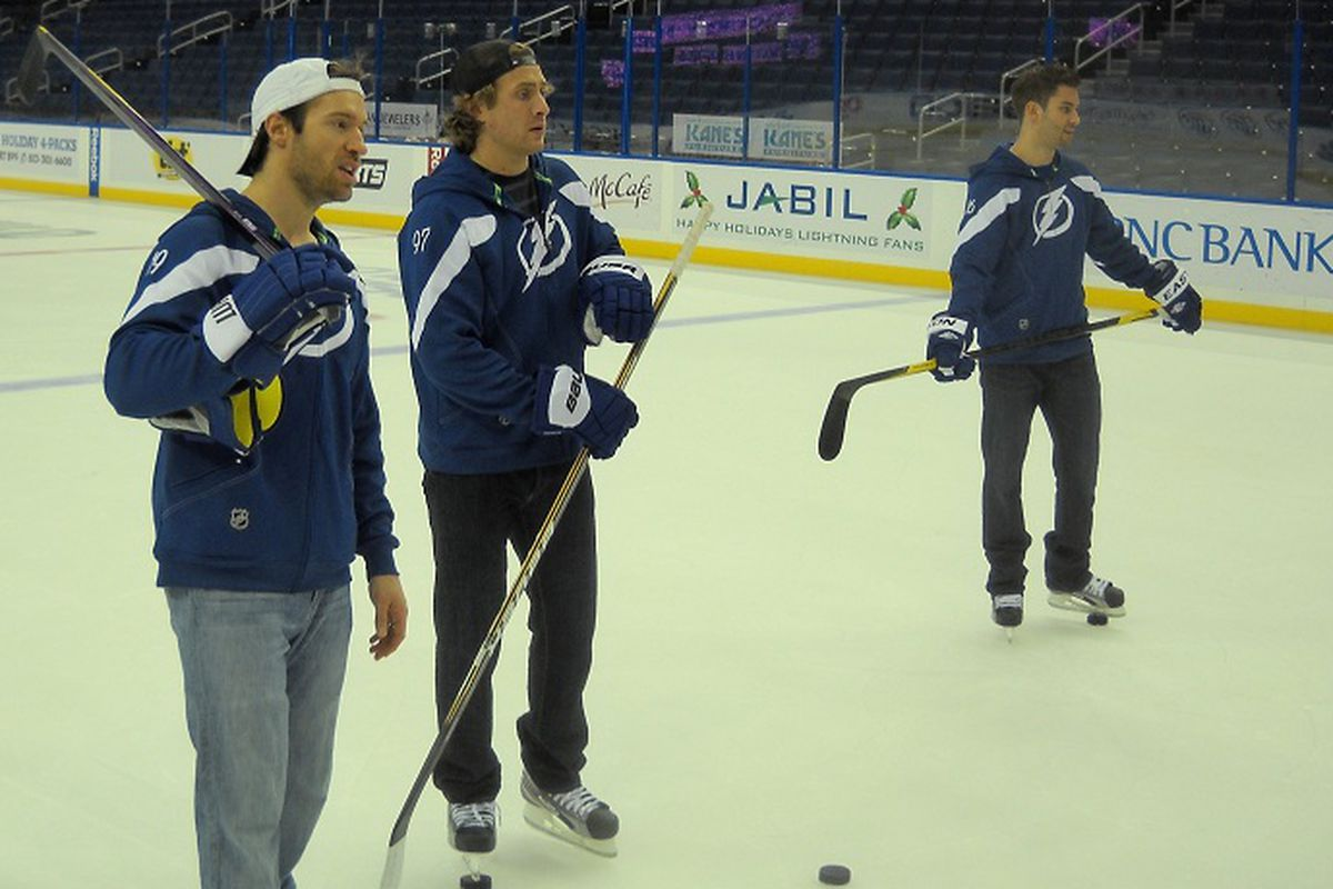 """Tampa Bay Lightning players Dominic Moore, Matt Gilroy and Teddy Purcell answer questions during Tuesday's """"Hockey N Heels"""" event at the St. Pete Times Forum (photo by Clark Brooks)"""