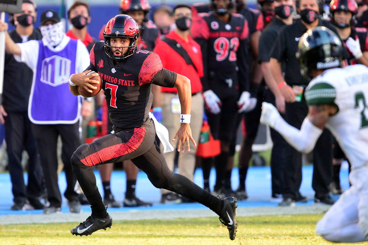 San Diego State Aztecs quarterback Lucas Johnson runs the ball against the Hawaii Warriors during the second half at Dignity Health Sports Park.