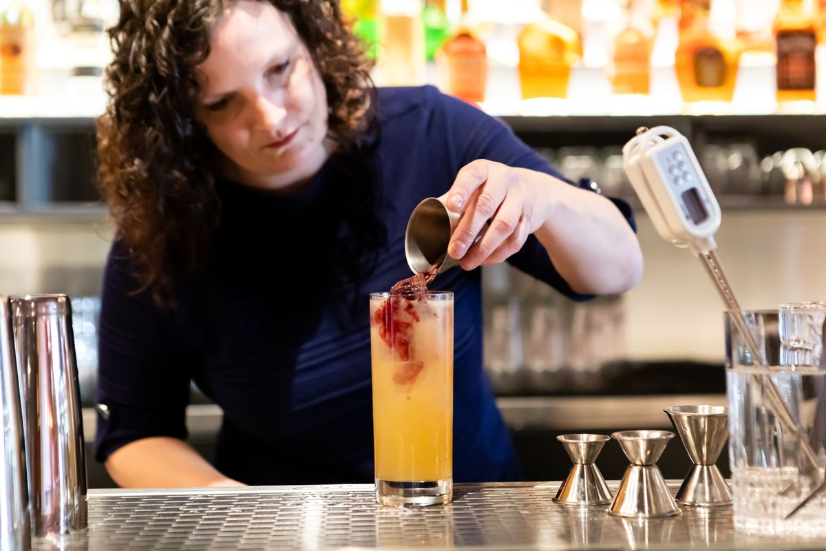 Owner Jennifer Colliau mixes a drink at Here's How