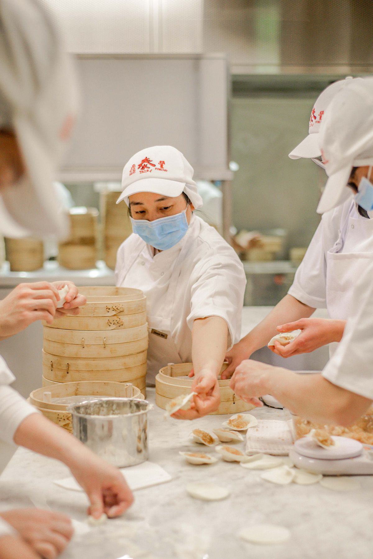 Xiaolongbao dumpling preparation at Taiwanese restaurant Din Tai Fung's first London opening in Covent Garden