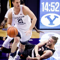 Brigham Young Cougars guard Trevin Knell (21) moves down court as Pacific Tigers guard Daniss Jenkins (4) hits the boards at the Marriott Center in Provo on Saturday, Jan. 30, 2021.