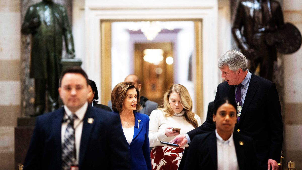 Speaker of the House Nancy Pelosi walking with reporters to the floor of the House of Representatives on March 27, 2020.