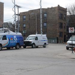 Media trucks parked in front of Bernie's -