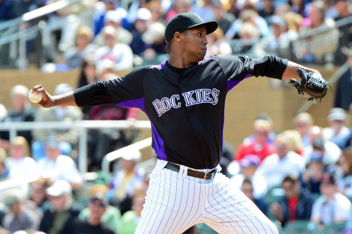 Colorado Rockies starting pitcher Juan Nicasio (44) throws during the first inning against the Los Angeles Angels at Salt River Fields at Talking Stick. Mandatory Credit: Matt Kartozian-US PRESSWIRE