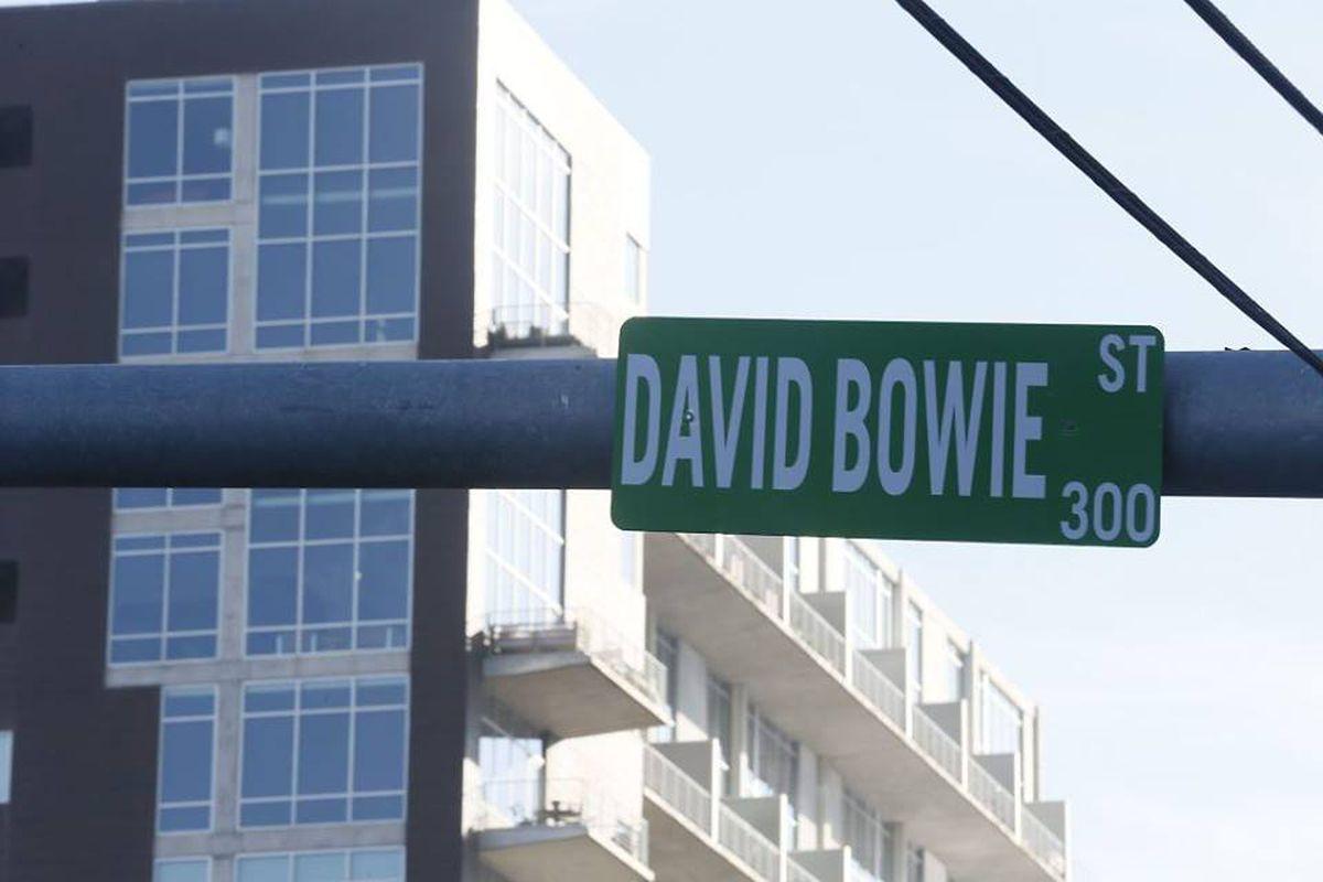 A street light sign that reads David Bowie Street