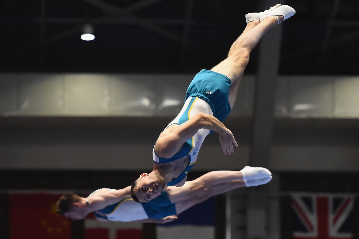 Dominic Clarke and Aiden Thomas of Australia compete during in synchronized trampoline at the 2018 World Cup in Japan.