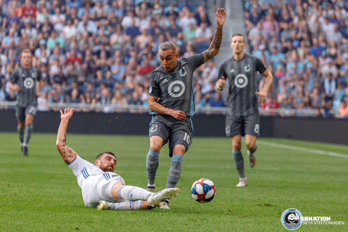 July 3, 2019 - Saint Paul, Minnesota, United States - San Jose defender Guram Kashia (37) comes in with a slide tackle to knock the ball away from Minnesota United midfielder Miguel Ibarra (10) during the match at Allianz Field.