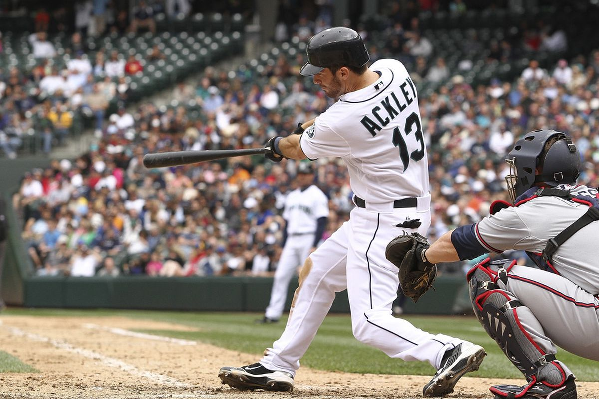 SEATTLE - JUNE 29:  Dustin Ackley #13 of the Seattle Mariners hits a two-run homer against the Atlanta Braves at Safeco Field on June 29, 2011 in Seattle, Washington. The Braves defeated the Mariners 5-3. (Photo by Otto Greule Jr/Getty Images)