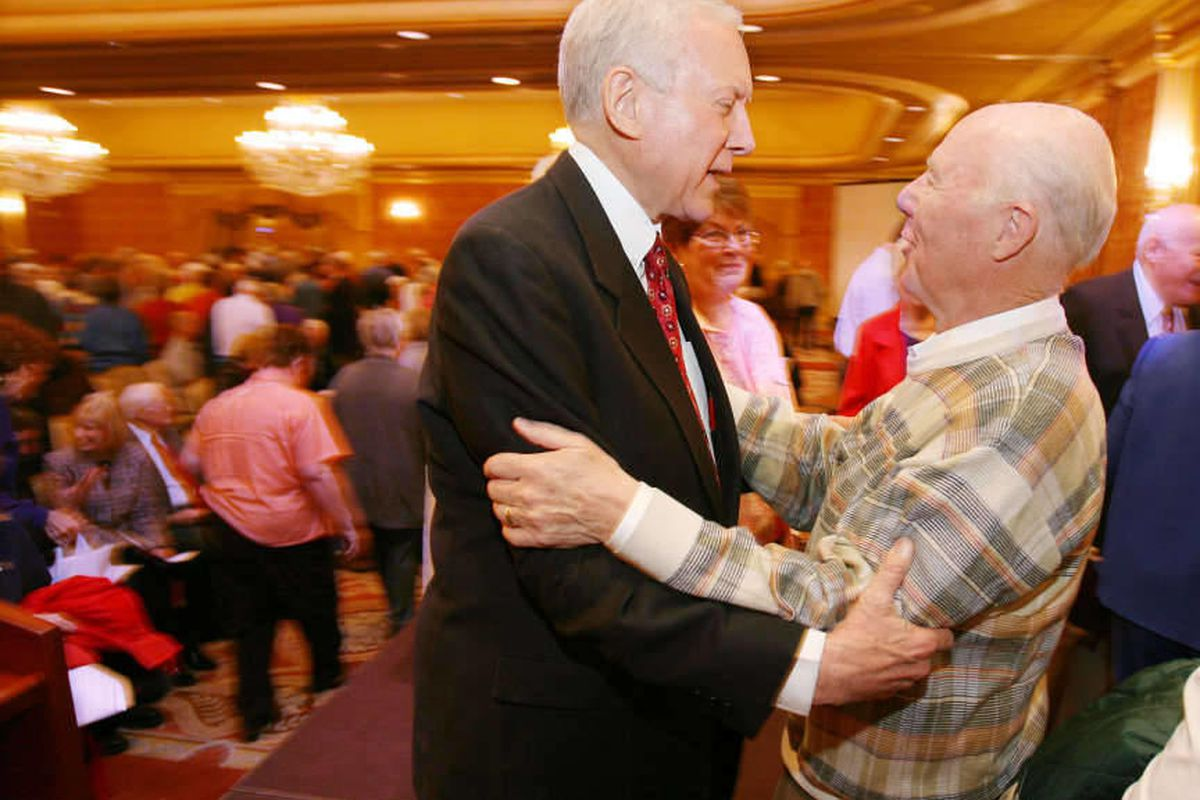 Orrin Hatch (L) talks with Scott Fisher at the 19th Annual Utah Conference for Seniors, April 18, 2006, at the Little America Hotel in Salt Lake City.