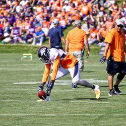 Broncos S Darian Stewart reaches for a loose ball during fumble drills.