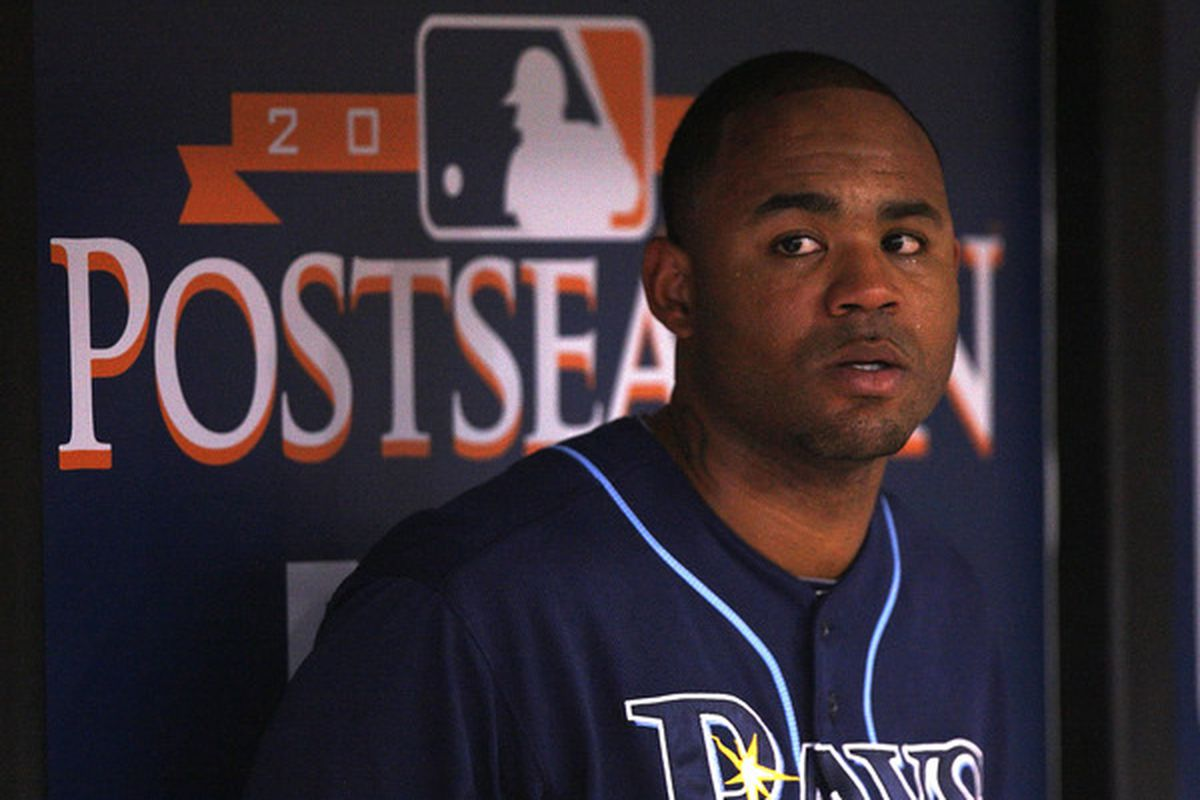 ST PETERSBURG FL - OCTOBER 07:  Carl Crawford #13 the Tampa Bay Rays waits in the dugout during Game 2 of the ALDS against the Texas Rangers at Tropicana Field on October 7 2010 in St. Petersburg Florida.  (Photo by Mike Ehrmann/Getty Images)