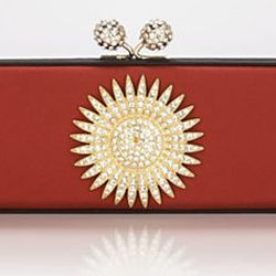 """<b>Badgley Mischka</b> Malve Clutch in spice, <a href=""""http://www1.bloomingdales.com/shop/product/badgley-mischka-clutch-malve?ID=630792&PseudoCat=se-xx-xx-xx.esn_results"""">$206.50</a> at Bloomingdale's"""