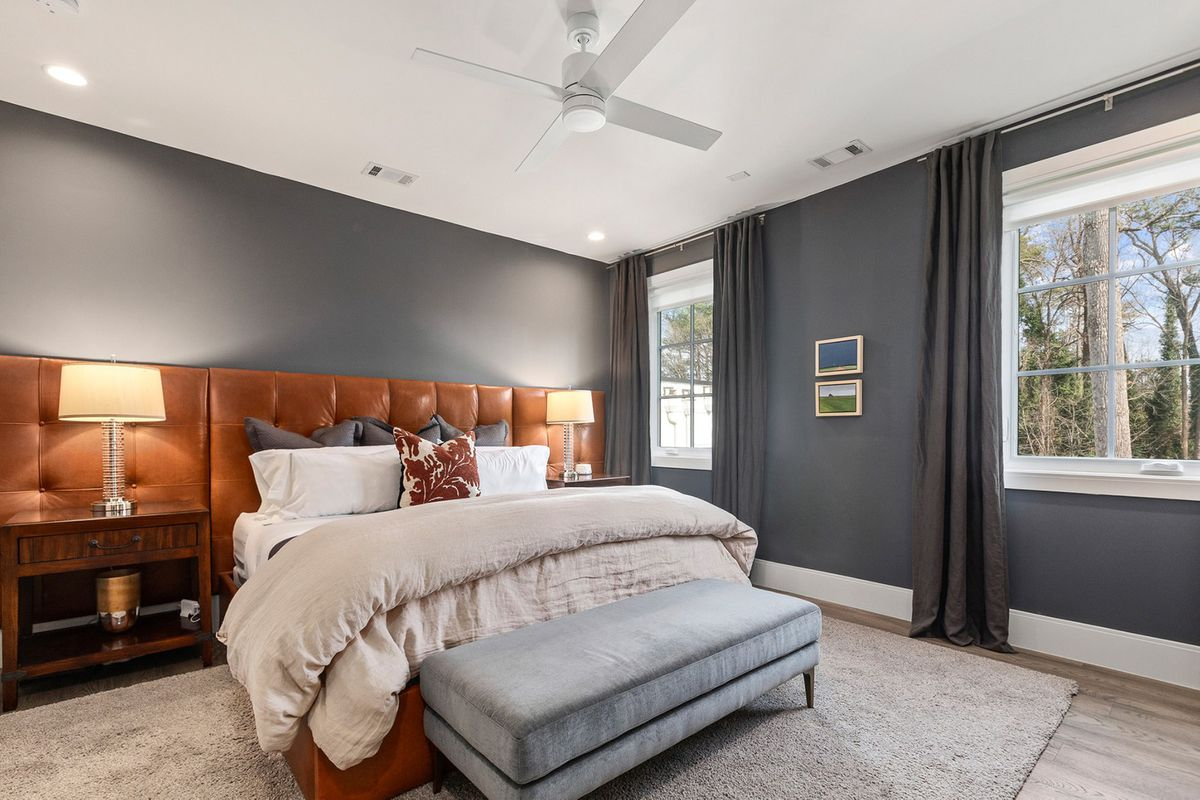 A master bedroom with gray walls.