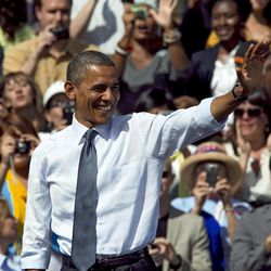 In this Sept. 13, 2012, photo, President Barack Obama waves after speaking at a campaign rally in Golden, Colo. A new poll shows Obama opening a double-digit lead over former Massachusetts Gov. Mitt Romney in two of the nation's three largest swing states.