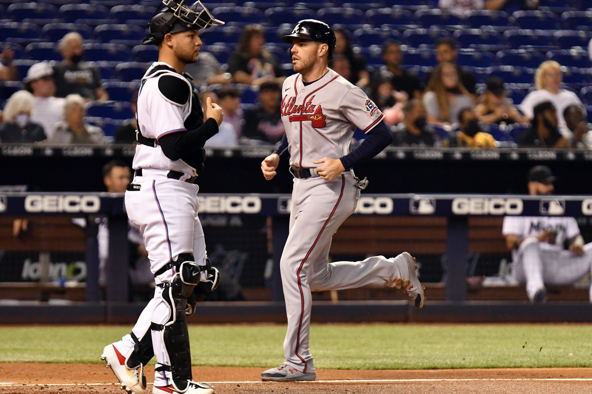 Atlanta Braves first baseman Freddie Freeman (5) scores a run in the fourth inning as Miami Marlins catcher Alex Jackson (23) looks on at loanDepot Park.