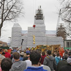 Crowds gather as workers prepare to place an Angel Moroni statue atop the Provo City Center Temple Monday, March 31, 2014, in Provo.