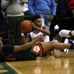 Curie's Dajuan Gordon (3) looks for help after stealing the ball from  Morgan Park's Adam Miller (44) during their 65-60 CPS championship  at Chicago State University in Chicago, Sunday, February 17, 2019. | Kevin Tanaka/For the Sun Times