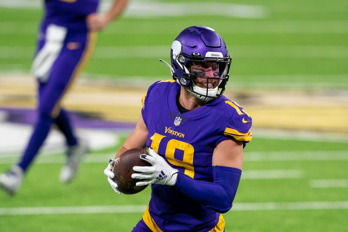 Minnesota Vikings wide receiver Adam Thielen runs after the catch in the third quarter against the Dallas Cowboys at U.S. Bank Stadium.