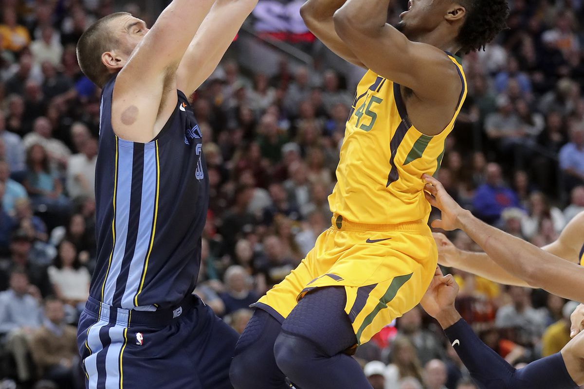 Utah Jazz guard Donovan Mitchell (45) shoots over Memphis Grizzlies center Marc Gasol (33) during an NBA basketball game at the Vivint Smart Home Arena in Salt Lake City on Monday, Oct. 22, 2018.