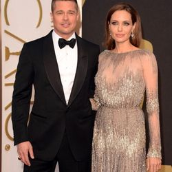 Brangelina are here! Brad's in Tom Ford and Angelina's wearing metallic Elie Saab.