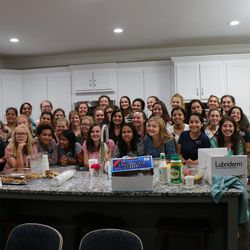 """Three dozen sister missionaries evacuated from the Mormon mission in Puerto Rico after Hurricane Maria pose in the Georgia Atlanta North mission home after eating a spaghetti dinner on Saturday, Sept. 23, 2017. """"It was a great honor to serve these young missionaries,"""" Atlanta North Mission President Scott Marsh said. """"They had huddled in their mission home for Hurricane Maria, had not showered in four or five days, did not have good access to information about what was going on around them, had lost most of their belongings which they simply had to leave behind and had to endure the emotions of leaving behind investigators, members, fellow missionaries and others still in harm's way.  Through it all they were cheerful, were filled with the spirit of the gospel and of their mission and were looking forward to the adventures awaiting them in their new missions."""""""