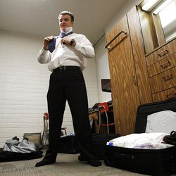 Elder John Scoggin ties his tie in preparation to leave the Provo Missionary Training Center of The Church of Jesus Christ of Latter-day Saints in Provo, Utah Tuesday, Feb. 15, 2011.