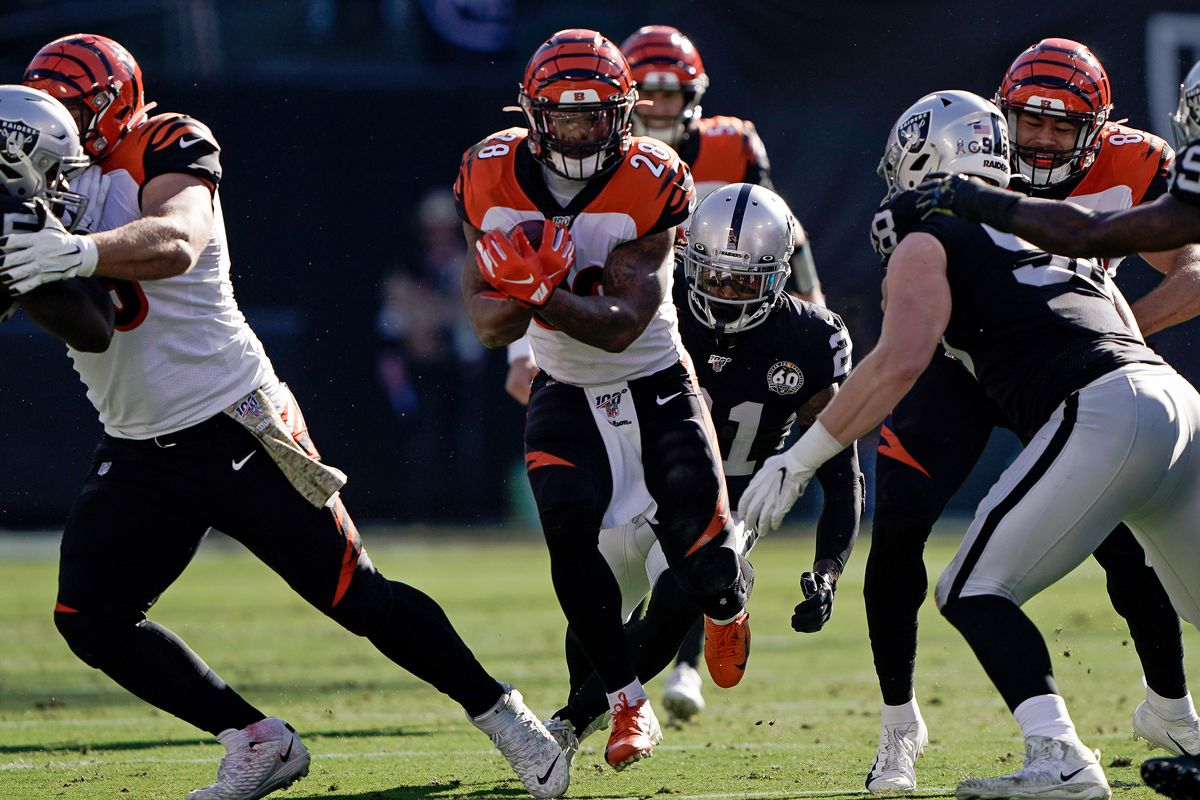 Cincinnati Bengals running back Joe Mixon runs with the football against the Oakland Raiders during the first quarter at the Oakland Coliseum.