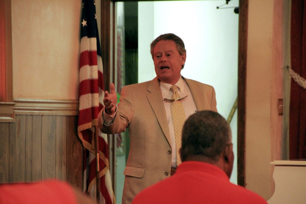 Attorney Bruce S. Kramer outlines legal options to supporters of Carver High School, which was shuttered this summer by Shelby County's school board.