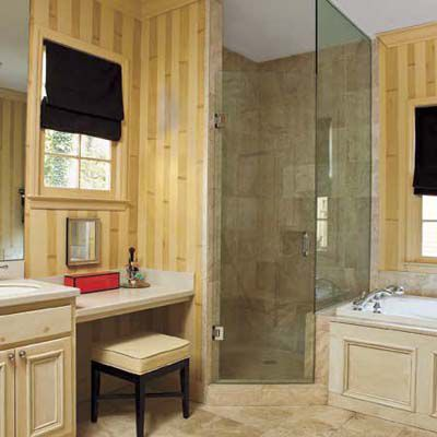 Decorative painting on bathroom walls to create bamboo and wood effect.