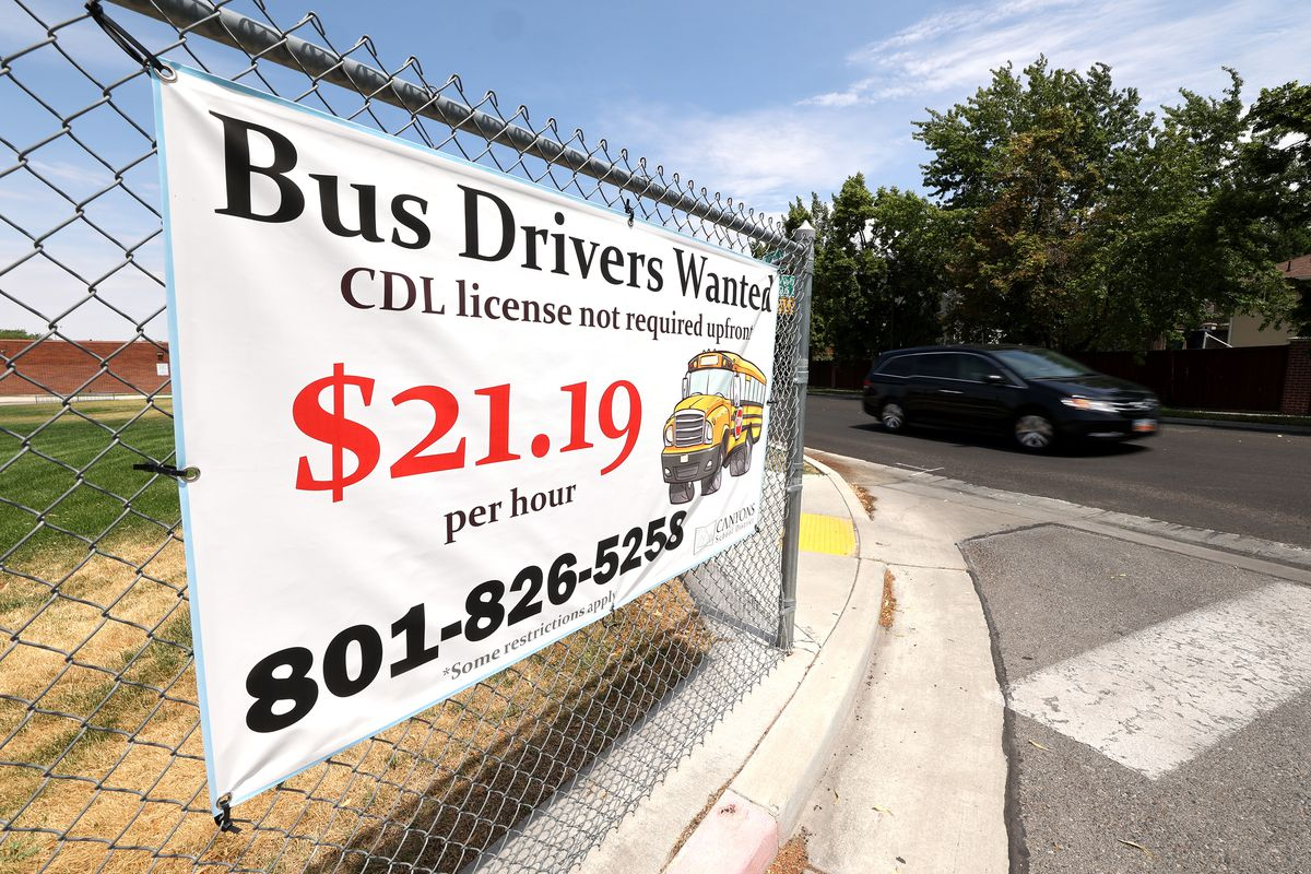 A sign offers $21.19 per hour for school bus drivers.