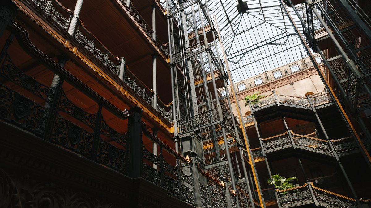 The interior of a building with very high ceilings and a skylight.
