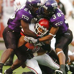 Utah's Quinton Ganther is sandwiched between TCU's Eric Buchanan (left) and Steven Coleman. Ganther was limited to 47 yards rushing.