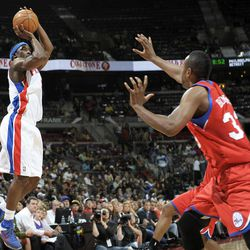 Detroit Pistons' Ben Gordon, left, shoots one of his eight three-point baskets against Philadelphia 76ers' Craig Brackins in the second quarter of an NBA basketball game on Thursday, April 26, 2012, in Auburn Hills, Mich. Gordon led the Pistons with 26 points in a 108-86 win.