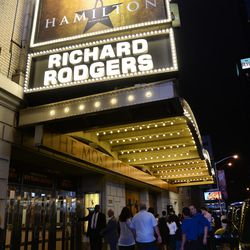"""People gather outside the """"Hamilton"""" marquee at the Richard Rogers Theatre on Saturday, July 9, 2016, in New York City."""
