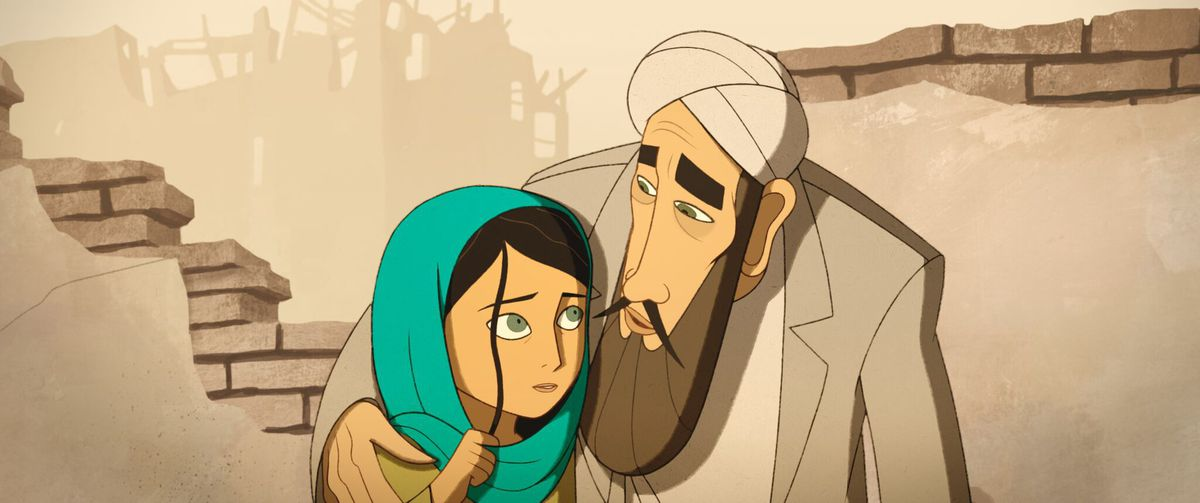 a young girl in a teal hijab looks up at a bearded man in a turban embracing her, with a broken wall and a destroyed building behind them, in a scene from the animated movie The Breadwinner