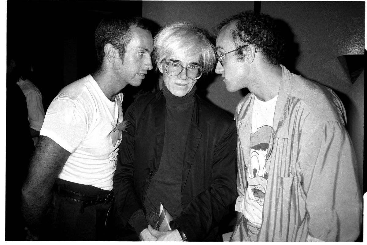 Kenny Scharf, Andy Warhol, and Keith Haring at Elizabeth Saltzman's birthday party at Il Cantinori