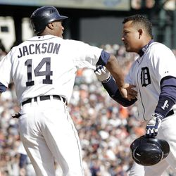 Detroit Tigers' Miguel Cabrera, right, is congratulated by Austin Jackson (14) after hitting a two-run home run to score the pair in the first inning of a baseball game against the Boston Red Sox Saturday, April 7, 2012, in Detroit. (AP Photo/Duane Burleson)