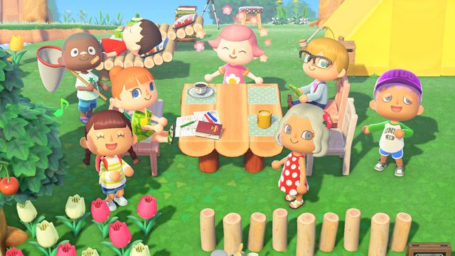 A group of eight residents gathered around a picnic table in Animal Crossing: New Horizons